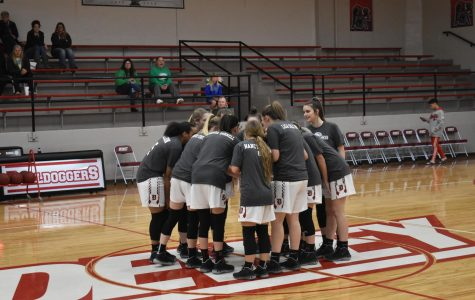 The girls wore shirts for cancer vs coaches during warm-ups.