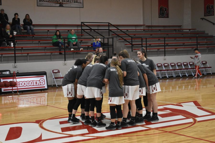 The+girls+wore+shirts+for+cancer+vs+coaches+during+warm-ups.+